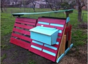 A frame pallet coop painted red and blue