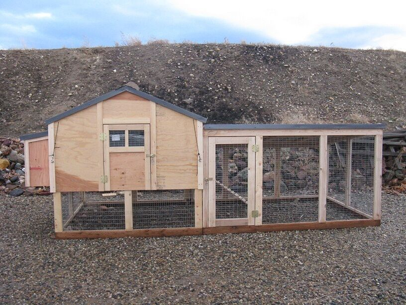 Large wooden enclosed chicken coop with run